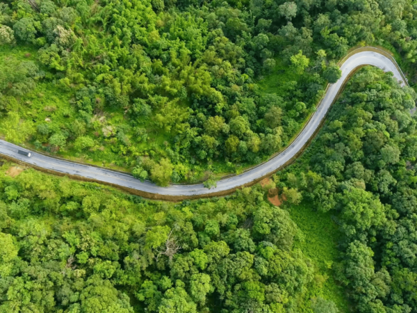 videoblocks-aerial-view-of-road-on-mountains-and-forest-with-truck-driving-up-hill-beautiful-nature-and-transportation-from-panoramic-view_hata8vv_z_thumbnail-full01